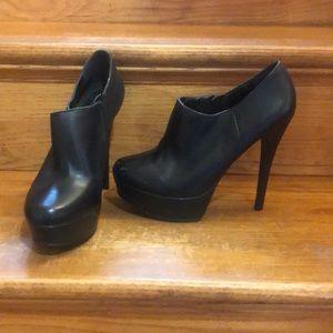 Black pleather high heel booties